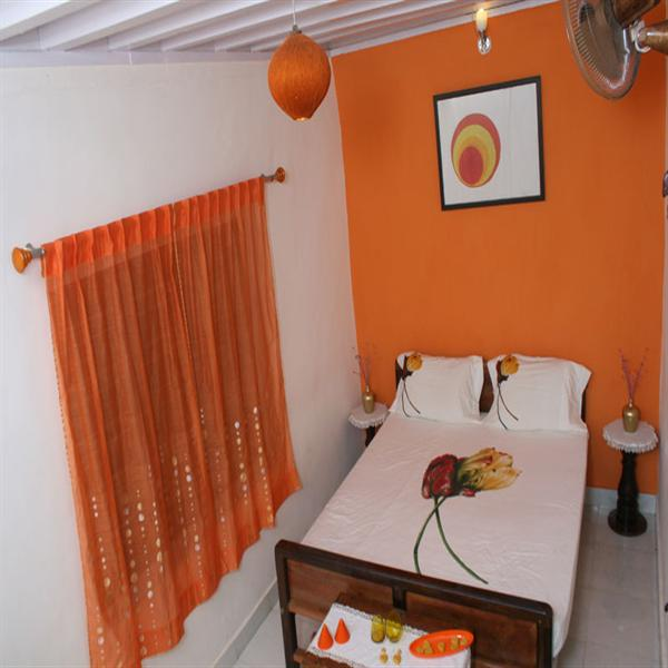Orange room at The Jade in Coorg